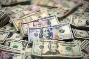 Picture of Dollar hovers above one-week low as Evergrande questions linger